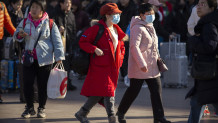 Κινέζοι με μάσκες