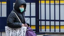 Γυναίκα με μάσκα - Εποχική γρίπη