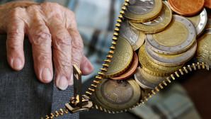 Γέρικο χέρι και κέρματα