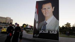 αφίσα με τον Μπασάρ Αλ Άσαντ