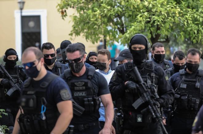 Υπό δρακόντεια μέτρα ασφαλείας η μεταγωγή του πιλότου στην Ευελπίδων- φωτογραφία Eurokinissi